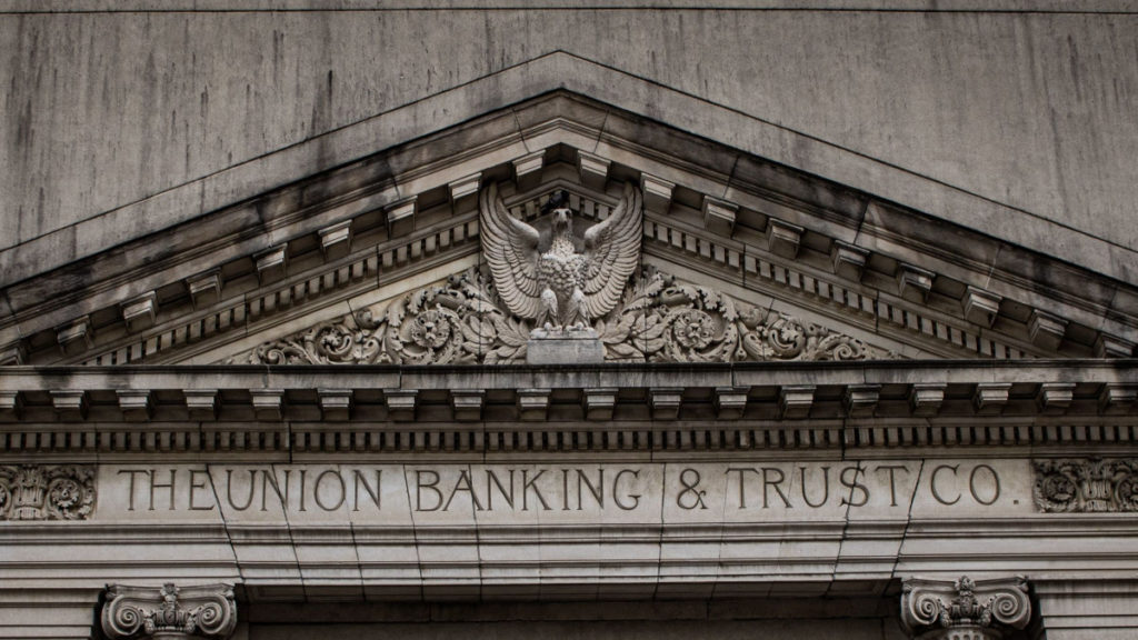A marble building facade reads The Union Banking & Trust Co.