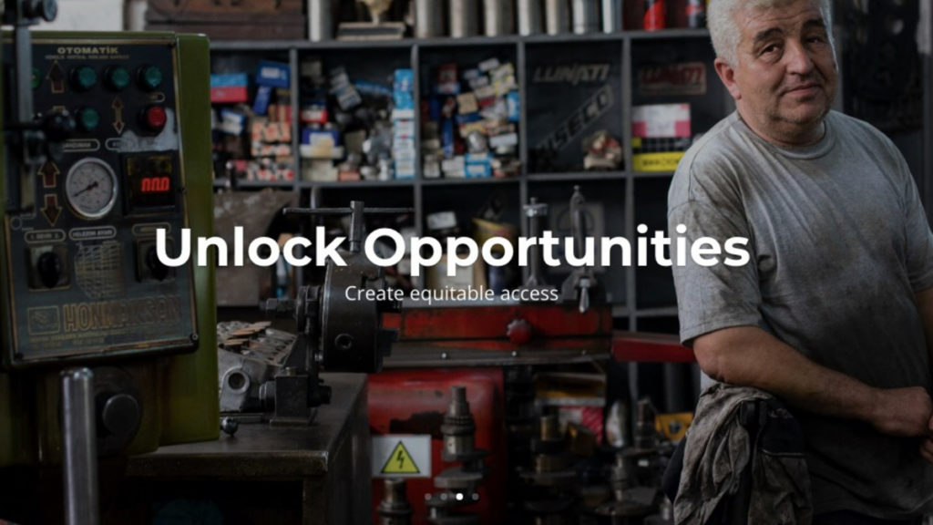 "A graphic courtesy of Startup Space shows a man with white hair standing in a garage, with text reading ""Unlock Opportunities. Create equitable access."""